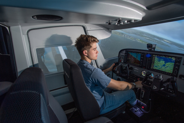 Kent State University Career Exploration and Development Aeronautics Student flying in aircraft simulation